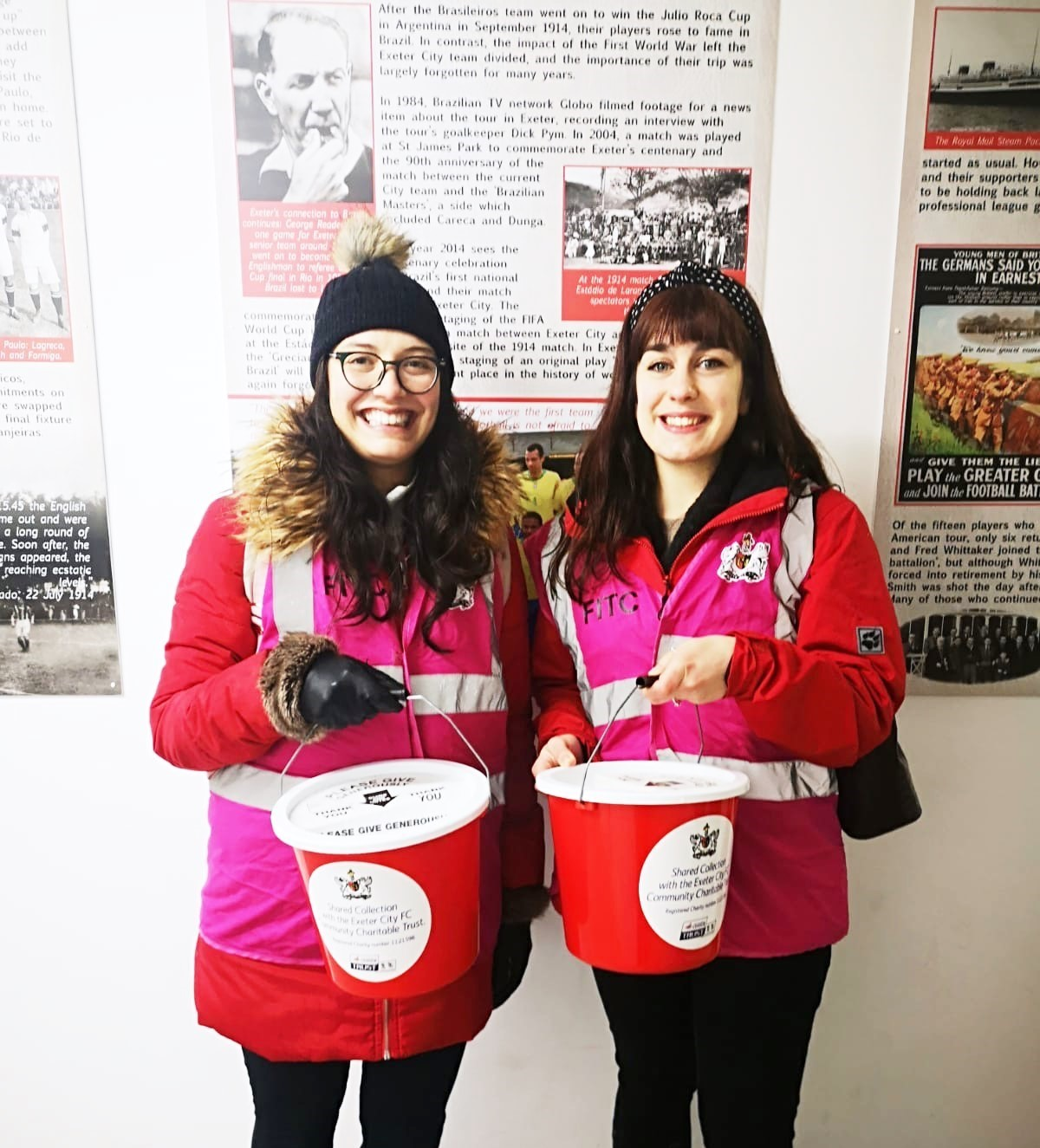 Sarah Heath and Antonia D'Alessio collecting bucket donations at Exeter City Football Club
